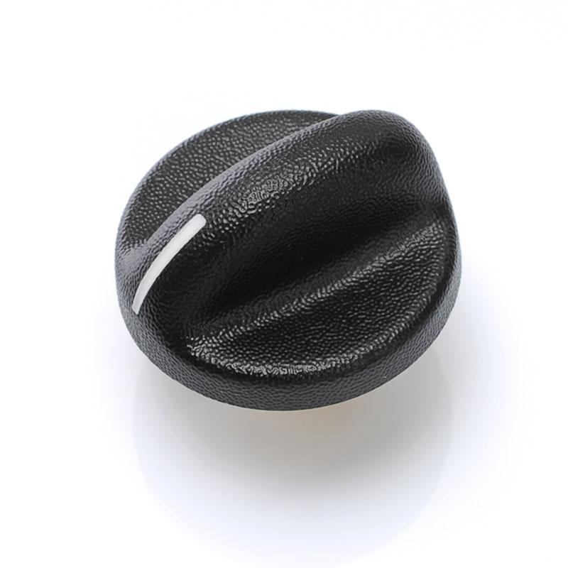 Bouton plastique injecté par surmoulage avec texture en surface